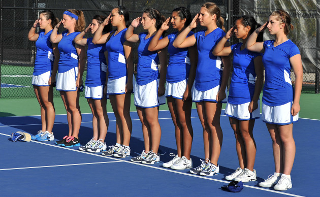 Nine cadets on the Air Force Academy women's tennis team salute at a match Sept. 22, 2012. The team is 12-5 overall and 1-1 in the Mountain West Conference. The team's last two home matches will take place April 12 and 14. (U.S. Air Force photo/Liz Copan)