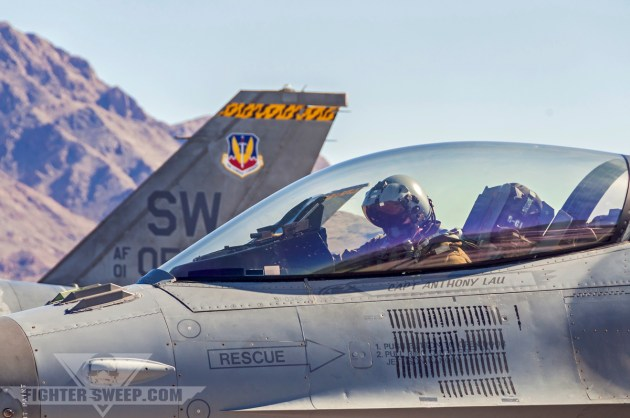 """Lieutenant Colonel Jason """"Nails"""" Plourde, then-commander of the 79th Fighter Squadron, goes through his pre-flight checks prior to launching for a Red Flag mission at Nellis AFB, NV."""