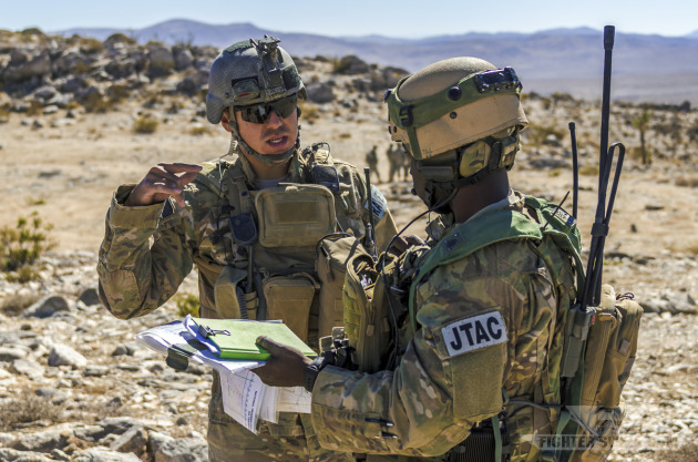 Two Air Force JTACs discuss mission parameters prior to calling in CAS for an exercise during Green Flag-West.