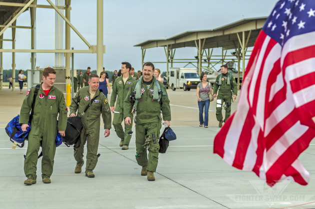 Members of the 55th Fighter Squadron return home after a four-month deployment to Southeast Asia.
