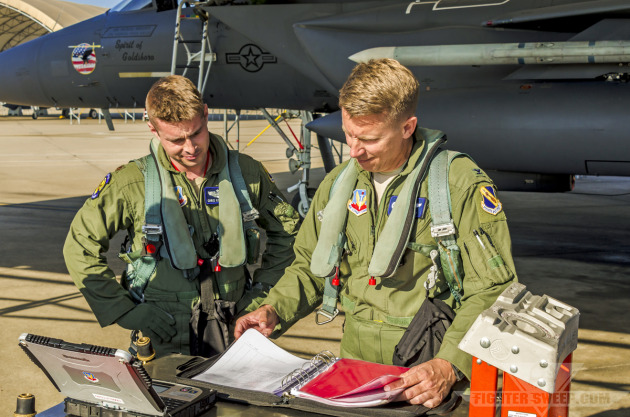 """Wyatt"" and ""Moon"" read over the maintenance logbook prior to launch for a Large Force Exercise at Seymour Johnson AFB, NC."