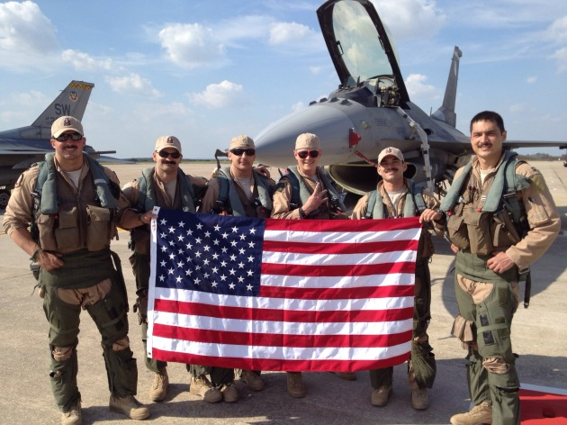 """Gamblers"" pose in front of a Block 50 F-16CJ upon completing a successful mission in support of Operation Enduring Freedom. Led by Lieutenant Colonel Johnny ""Vegas"" Vargas, the 77th FS flew more than 20,000 combat hours and dropped more than 1,000 munitions over a two-year period. (Photo courtesy of Major Mike ""Tazer"" Chebino)"