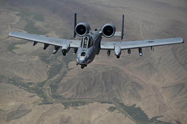 An A-10 Thunderbolt II moves into position behind a KC-135 Stratotanker before refueling. The A-10, deployed to Afghanistan from Moody AFB, Ga., in on a mission providing close air support to coalition forces in Afghanistan.