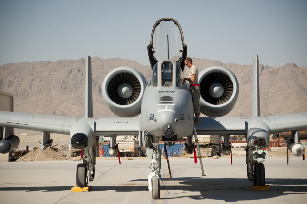 Tech. Sgt. Ben Jonkman, 107th Expeditionary Fighter Squadron weapons load crew chief, prepares an A-10 Thunderbolt for flight at Kandahar Airfield, Afghanistan, Dec. 2, 2011. The A-10 fires a 30-millimeter cannon and can carry up to 16,000 pounds of ordnance for close air support missions to support troops on the ground.