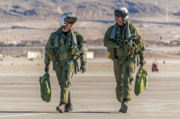 The crew of a US Navy EA-18G Growler return after a Red Flag training mission at Nellis AFB, Nevada.