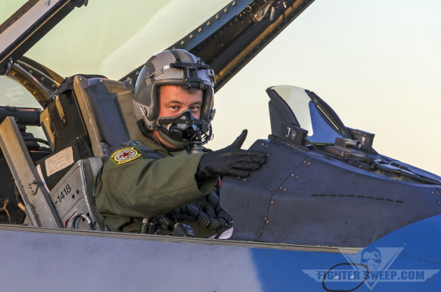 An F-16C pilot with the 64th Aggressor Squadron starts his jet in preparation for a night training mission during Red Flag.