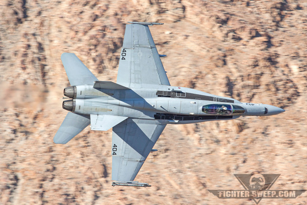 "Just prior to converting to Super Hornets, this C-model from VFA-192 the ""World Famous Golden Dragons"" is descending through Star Wars Canyon on the Sidewinder Route in Death Valley, CA. SSHWFGD!"