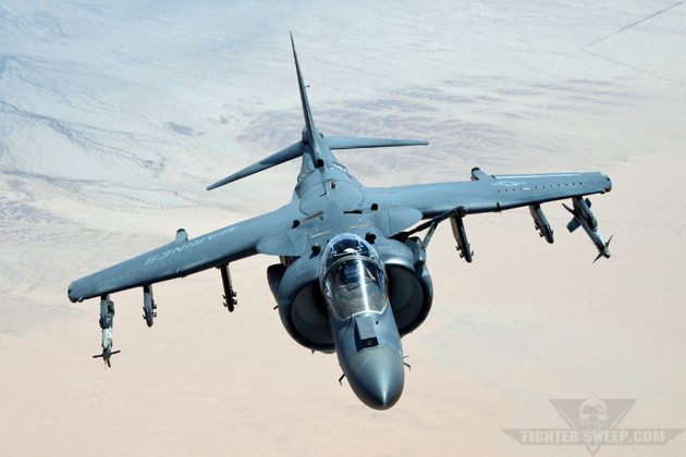 A USMC AV-8B pulls up to the tanker to get fuel during a WTI sortie.