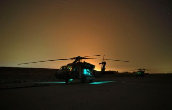 """Aircraft from HSC-84 await an """"exfil"""" call after inserting Army SOF earlier on a target in Iraq."""
