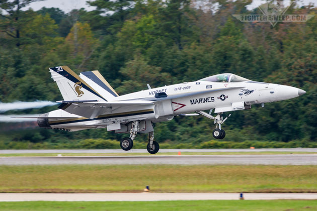 "A Legacy F/A-18C Hornet from VFA-106 ""Gladiators"" in a stunning celebratory ""30 Years of Hornet"" paint scheme simulates a bolter while performing at the NAS Oceana Airshow"