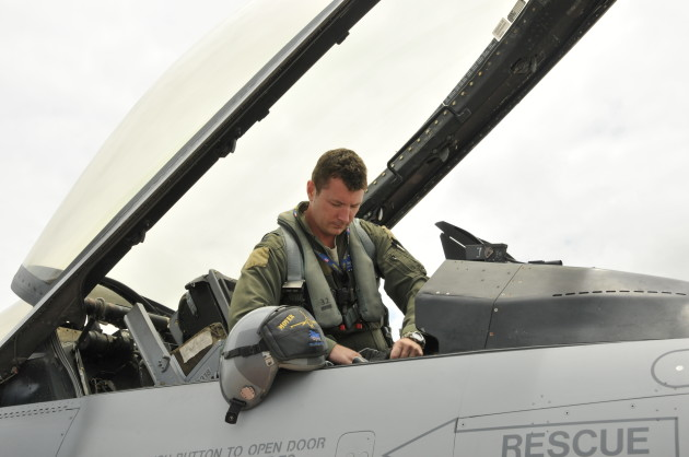 """The helmet riding """"Viper standard"""" as the author settles into the cockpit."""