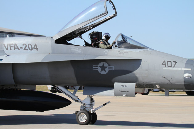 """Mover"" settled into the cockpit of his F/A-18 prior to a training mission out of Navy New Orleans."