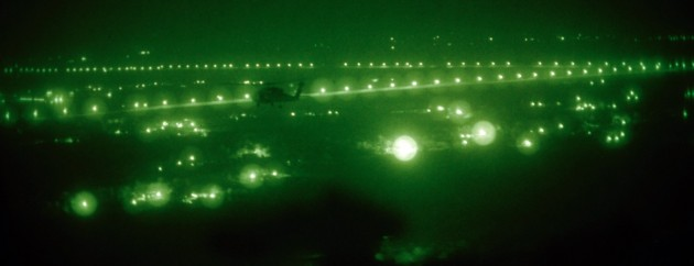 An HSC-84 aircraft transiting over Iraq. Note the blooming effect on the NVGs caused by the cultural lighting.