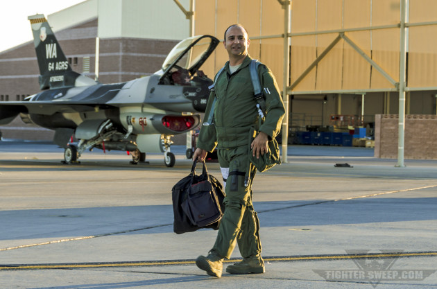 """Lieutenant Colonel Cameron """"Glover"""" Dadgar steps to his aircraft prior to a training mission during Red Flag."""