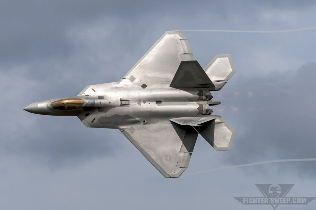 A Lockheed-Martin F-22A Raptor rages through the airspace above Joint Base Elmendorf-Richardson in Alaska during a combat airpower demonstration.