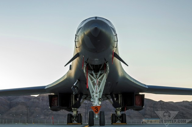 A Boeing B-1B sits on the ramp at Nellis AFB during sunrise.