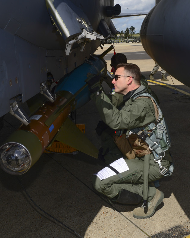 Colonel Novotny inspects an inert training bomb on an F-15E Strike Eagle prior to taking off for a training mission. (Photo Courtesy of 48th Fighter Wing Public Affairs)