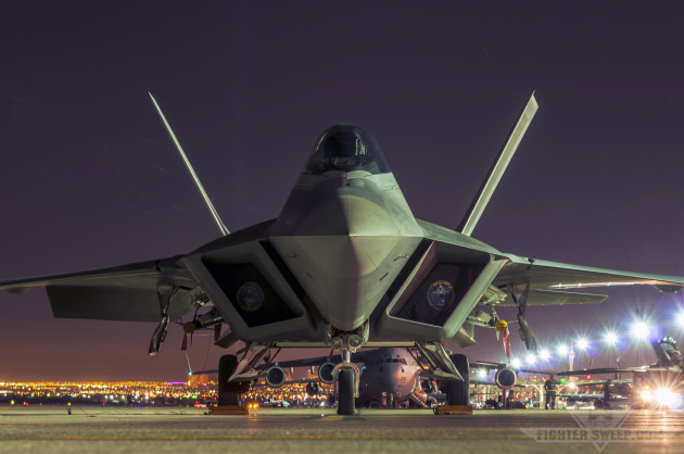 A Lockheed-Martin F-22A Raptor sits on the Nellis AFB ramp at night. Note the tapered design of the canopy.