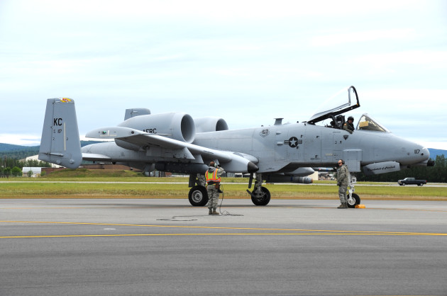 A member of the 442nd Maintenance Squadron salutes an A-10 Thunderbolt II pilot signaling completion of end-of-runway checks prior to taxi and takeoff here, July 18, 2012. The 442 FW, is an Air Force Reserve Unit, from Whiteman Air Force Base, Mo. deployed here for training.(U.S. Air Force photo/Staff Sgt. Lauren Padden)
