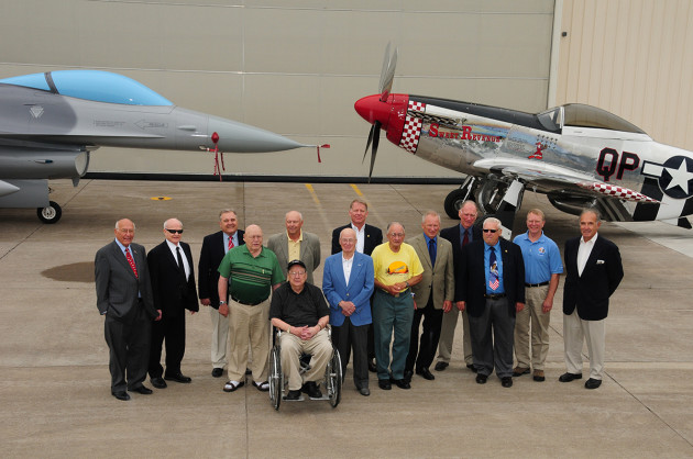 Former 148th Fighter Wing members along with other special guests pose for a group shot with the P-51 Mustang and the block 10, F-16 during the Minnesota Air National Guard's 90th Anniversary celebration. The P-51 Mustang is the original aircraft flown by the 148th Fighter Wing and was flown from 1948 to 1954. (U.S. Air Force photo by Master Sgt. Ralph Kapustka/released)