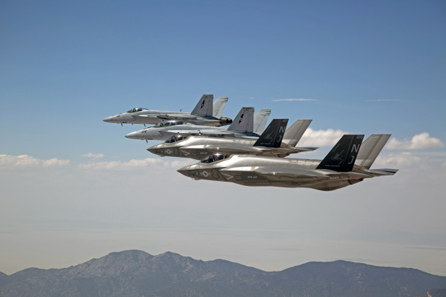 F-35C Lightning IIs, assigned to the Grim Reapers of Strike Fighter Squadron (VFA) 101, and an F/A-18E/F Super Hornets assigned to the Naval Aviation Warfighter Development Center (NAWDC) fly over Naval Air Station Fallon's (NASF) Range Training Complex. VFA 101, based out of Eglin Air Force Base, is conducting an F-35C cross-country visit to NASF. The purpose is to begin integration of F-35C with the Fallon Range Training Complex and work with NAWDC to refine tactics, techniques and procedures (TTP) of F-35C as it integrates into the carrier air wing. (U.S. Navy photo by Lt. Cmdr. Darin Russell/Released)