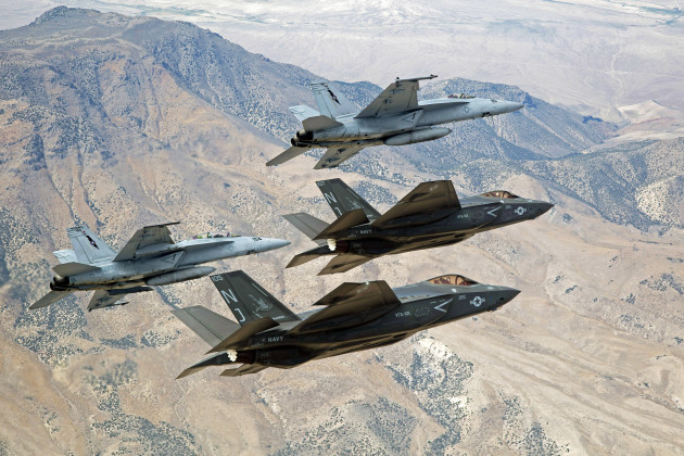 F-35C Lightning IIs, attached to the Grim Reapers of Strike Fighter Squadron (VFA) 101, and an F/A-18E/F Super Hornets attached to the Naval Aviation Warfighter Development Center (NAWDC) fly over Naval Air Station Fallon's (NASF) Range Training Complex. VFA 101, based out of Eglin Air Force Base, is conducting an F-35C cross-country visit to NASF. The purpose is to begin integration of F-35C with the Fallon Range Training Complex and work with NAWDC to refine tactics, techniques and procedures (TTP) of F-35C as it integrates into the carrier air wing. (U.S. Navy photo by Lt. Cmdr. Darin Russell/Released)