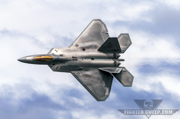 A Lockheed-Martin F-22A Raptor cranks through a 9-G turn at .92 Mach over Joint Base Elmendorf-Richardson, Alaska.