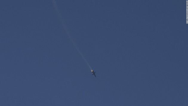 A Russian Air Force Su-24M Fencer plummets toward earth after being shot down by a Turkish F-16. (AP/Reuters)