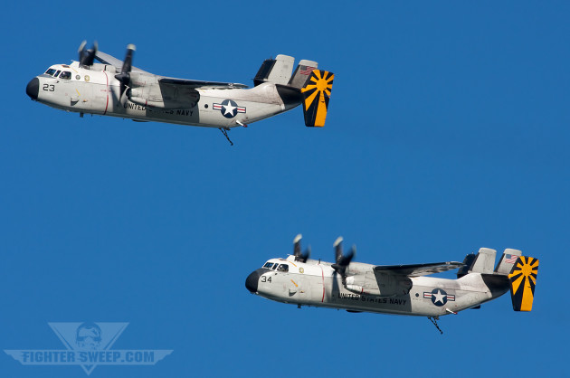 "A pair of C-2s from VRC-30 ""Providers"" taking part in the Centennial of Naval Aviation flypast"