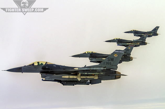 """A four-ship of F-16CJ """"Super Weasels"""" from the 55th Fighter Squadron prowl the sky in northern Georgia."""