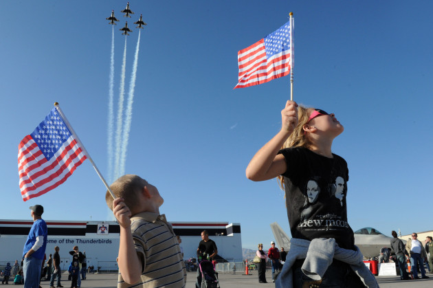 """Admiring young patriotic fans cheer on the U.S. Air Force Air Demonstration Squadron """"Thunderbirds"""", as they perform the Diamond Opener during the Aviation Nation Air Show at Nellis Air Force Base, Nev., Nov. 12, 2011. (U.S. Air Force photo/Staff Sgt. Larry E. Reid Jr., Released)"""