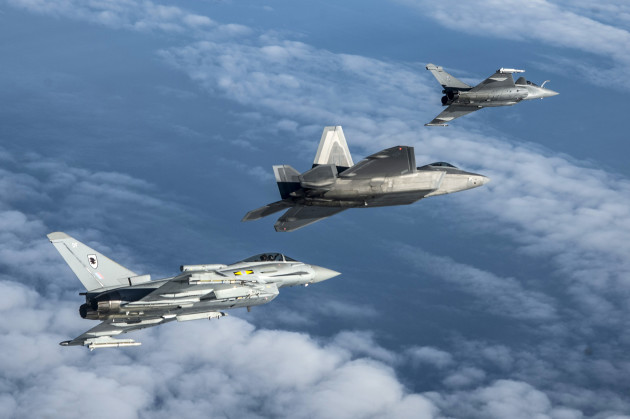 A British Royal Air Force Typhoon, U.S. Air Force F-22 Raptor and French air force Rafale fly in formation as part of a Trilateral Exercise held at Langley Air Force Base, Va., Dec. 7, 2015. The 5th generation aircraft involved in the exercise are the most technologically advanced assets in the world today. (U.S. Air Force photo by Senior Airman Kayla Newman)