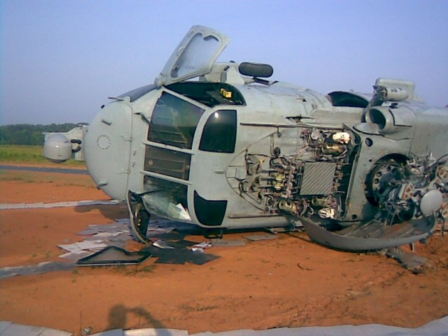 """A Seahawk helicopter flown by the """"Red Wolves"""" of Helicopter Sea Combat Squadron (HSC) 84 crashed during night training exercises in July 2009. The two pilots and four crewmembers received minor injuries. The Navy ruled the crash a Class """"A"""" mishap with damages to the aircraft exceeding $1million. (U.S. Navy photo/Released)"""