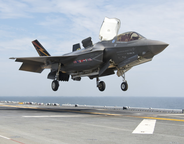 An F-35B Lightning II aircraft lands aboard the amphibious assault ship USS Wasp (LHD 1) during the second at-sea F-35 developmental test event. The F-35B is the Marine Corps variant of the Joint Strike Fighter and is undergoing testing aboard Wasp. (U.S. Navy photo courtesy of Lockheed Martin by Andy Wolfe/Released)/Released)