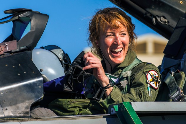 """""""SHOCK"""" smiles at the crowd gathering around her jet at the conclusion of her Fini-Flight and distinguished career flying the F-16. (Photo by Scott Wolff)"""