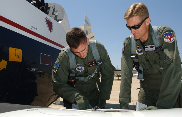 Student pilot 2nd Lt. Grant Webber and instructor pilot Lt. Col. Mike Jansen perform pre-flight checks on a T-6 Texan aircraft at Vance AFB, Okla. (U.S. Air Force photo/ Staff Sgt. Brian Hill)