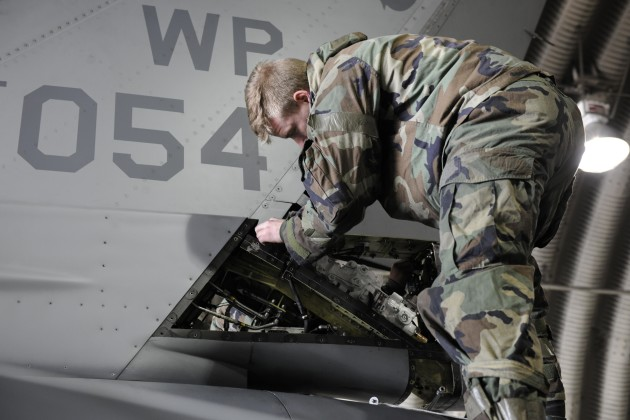 Staff Sgt. Brandon Rauchy, 80th Aircraft Maintenance Squadron dedicated crew chief, works on removing a rudder servo actuator on an F-16 Fighting Falcon during Beverly Pack 16-2 at Kunsan Air Base, Republic of Korea, Feb. 3, 2015. Airmen work around the clock no matter the condition during the exercises here on Kunsan. (U.S. Air Force photo by Senior Airman Dustin King/Released)