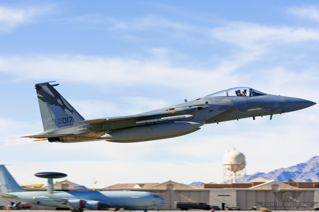 A McDonnell Douglas F-15C from the California Air National Guard's 144th Fighter Wing departs during Red Flag Period 16-1 at Nellis Air Force Base, Nevada. (Photo by Scott Wolff)