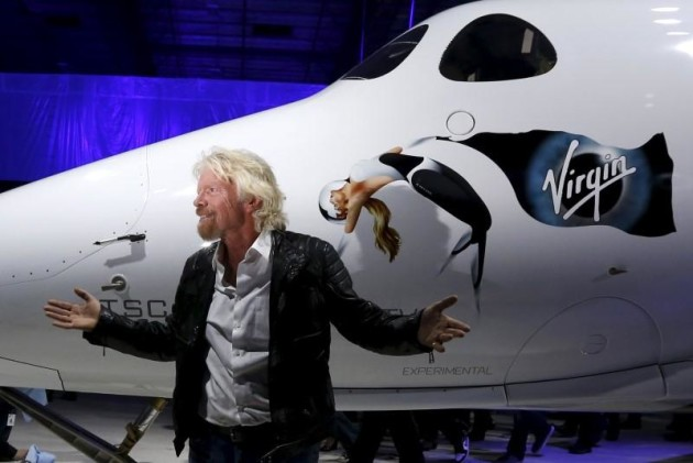 Richard Branson poses after unveiling the new SpaceShipTwo, a six-passenger two-pilot vehicle meant to ferry people into space that replaces a rocket destroyed during a test flight in October 2014, in Mojave, California, United States, February 19, 2016. REUTERS/Lucy Nicholson