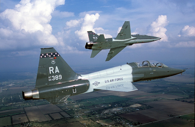 Air-to-air right side view of an USAF T-38 Talon aircraft from 560th Flying Training Squadron, Randolph AFB, TX as his wingman banks to the left.