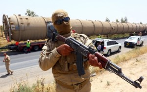 ISIL Fighter with oil reserves, Photo from aljazeera.com