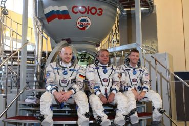 At the Gagarin Cosmonaut Training Center in Star City, Russia, Expedition 38/39 backup crewmembers Flight Engineer Alexander Gerst of the European Space Agency (left), Soyuz Commander Max Suraev (center) and NASA Flight Engineer Reid Wiseman (right) pose for pictures in front of a Soyuz simulator,NASA/Stephanie Stoll
