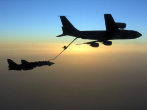 An F-14 Tomcat conducts aerial refueling with a U.S. Air Force KC-135 Stratotanker during a mission. U.S. Navy photo