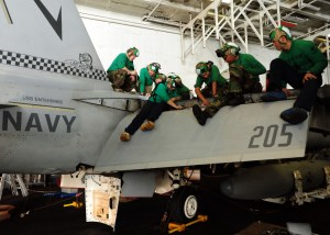 Sailors assigned to the Checkmates of Strike Fighter Squadron (VFA) 211 perform corrosion prevention maintenance on an F/A-18F Super Hornet (US Navy photo-Mass Communication Specialist 3rd Class Jared King)