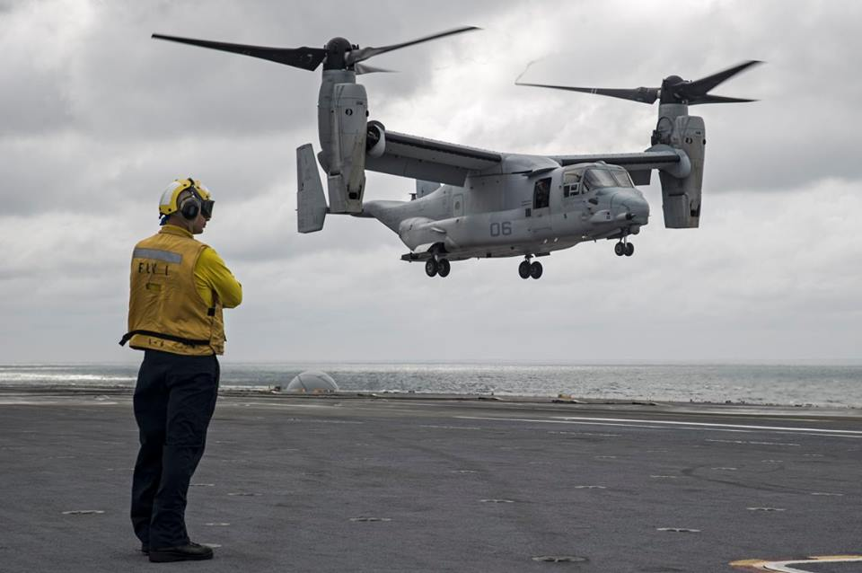 Petty Officer 2nd Class Brandon McCallum, from White Cloud, Mich., observes as an MV-22B Osprey transport aircraft assigned to the Blue Knights of Marine Medium Tiltrotor Squadron (VMM) 365 prepares to land on the flight deck of the aircraft carrier USS George Washington (CVN 73). George Washington, homeported in Norfolk, is underway in the Atlantic Ocean. (U.S. Navy photo by Petty Officer 3rd Class Bryan Mai)