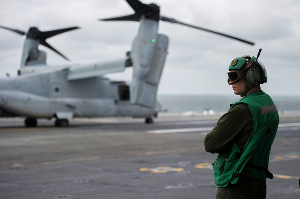 Cpl. Nicholas Beattie prepares to unload a MV-22B Osprey transport aircraft assigned to Marine Medium Tiltrotor Squadron (VMM) 365 aboard the aircraft carrier USS George Washington (CVN73). George Washington, homeported in Norfolk, is underway in the Atlantic Ocean. (U.S. Navy photo by Seaman Jonathan Price)