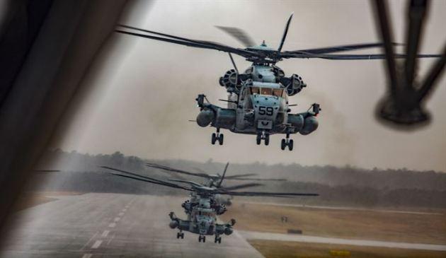 US Marine Corps CH-53E Super Stallions take a during a Max Launch
