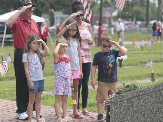 Veteran Tom Dellatore salutes fallen servicemen