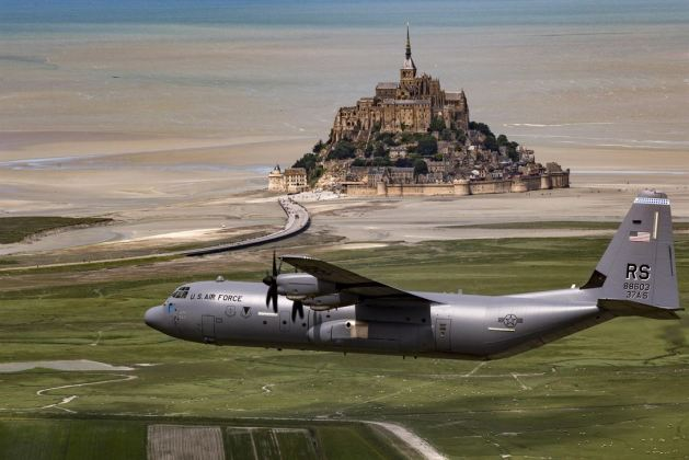 Air Force Brig Gen Richard G Moore Jr flies a C-130J Super Hercules past Mont Saint-Michel in Normandy