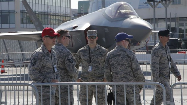US servicemen gather next to a F-35 Lightning II at Paris Air Show